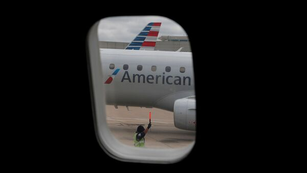 FILE PHOTO: An airlines worker signals next to an American Airlines plane that arrived at Hartsfield–Jackson Atlanta International Airport, as the coronavirus disease (COVID-19) continues, in Atlanta, Georgia, U.S., May 19, 2020. REUTERS/Shannon Stapleton/File Photo - Sputnik International