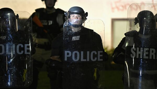 Police and members of the Sheriff's department hold a perimeter, during a protest after a Black man identified as Jacob Blake was shot several times by police last night, outside the Kenosha County Courthouse in Kenosha, Wisconsin, U.S. August 24, 2020 - Sputnik International