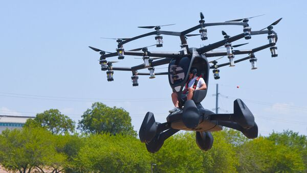 Matt Chasen, LIFT Aircraft chief executive officer, pilots the electric vertical takeoff and landing (eVTOL) Hexa over Camp Mabry, Texas, Aug. 20, 2020. - Sputnik International