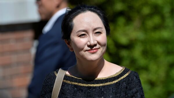 Huawei Technologies Chief Financial Officer Meng Wanzhou smiles as she leaves her home to attend a court hearing in Vancouver, British Columbia, Canada May 27, 2020. - Sputnik International