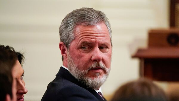 Jerry Falwell Jr., president of Liberty University, awaits the arrival of U.S. President Donald Trump to sign an executive order linking free speech efforts at public universities to federal grants in the East Room at the White House in Washington, U.S., March 21, 2019. - Sputnik International