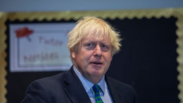 Britain's Prime Minister Boris Johnson visits Castle Rock school on the pupil's first day back to school, in Coalville, Britain 26 August 2020.  - Sputnik International