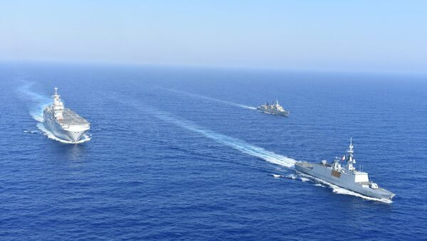 Greek and French vessels sail in formation during a joint military exercise in Mediterranean sea, in this undated handout image obtained by Reuters on August 13, 2020. - Sputnik International