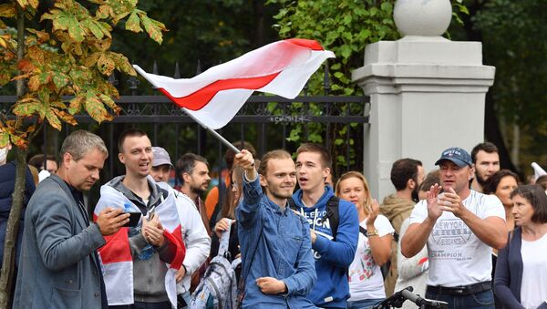 Participants of the rally in support of members of the Belarus Presidium of the Opposition Coordination Council Maxim Znaak and Sergei Dylevsky  - Sputnik International
