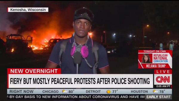 Screenshot of CNN live report from Kenosha protests, dubbed with the chyron FIERY BUT MOSTLY PEACEFUL PROTESTS AFTER POLICE SHOOTING - Sputnik International