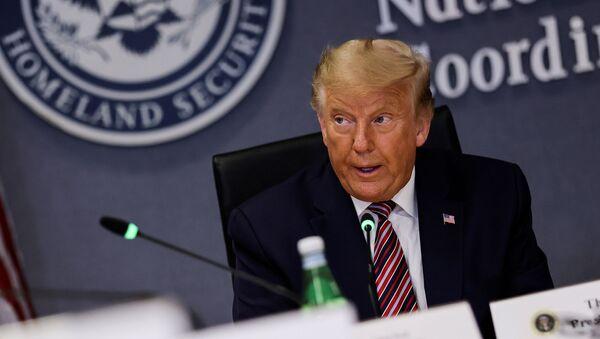 U.S. President Donald President Trump listens during a briefing on Hurricane Laura at the Federal Emergency Management Agency (FEMA) headquarters in Washington, U.S., August 27, 2020. - Sputnik International