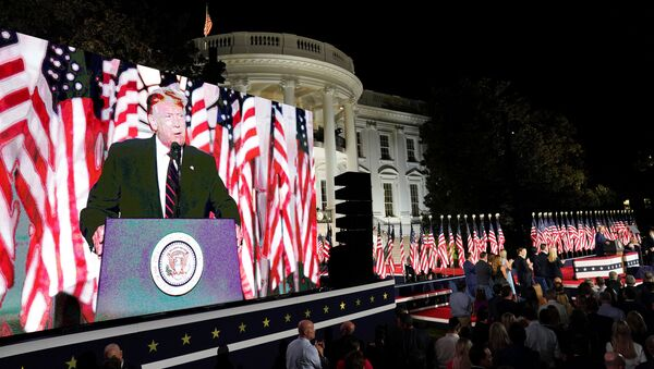 U.S. President Donald Trump is projected in a screen as he delivers his acceptance speech as the 2020 Republican presidential nominee during the final event of the Republican National Convention on the South Lawn of the White House in Washington, U.S., August 27, 2020.  - Sputnik International
