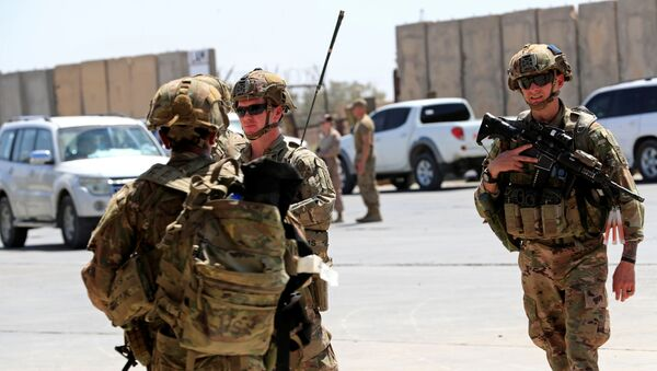 U.S. soldiers are seen during a handover ceremony of Taji military base from US-led coalition troops to Iraqi security forces, in the base north of Baghdad, Iraq August 23, 2020. REUTERS/Thaier Al-Sudani - Sputnik International
