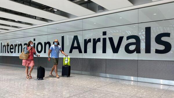Passengers from international flights arrive at Heathrow Airport, following the outbreak of the coronavirus disease (COVID-19), London, Britain, July 29, 2020 - Sputnik International
