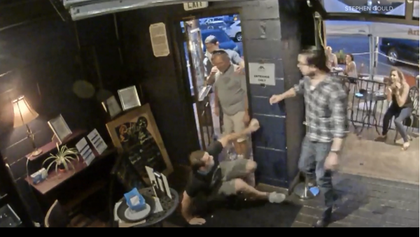 A screenshot from a video showing a customer shoving a bartender in the Golden Moon Speakeasy in the US state of Colorado. - Sputnik International