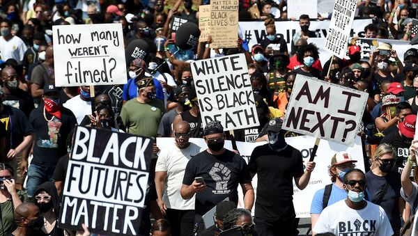 People holding placards attend the 'Get Your Knee Off Our Necks' march in support of racial justice, in Washington, U.S., August 28, 2020 - Sputnik International