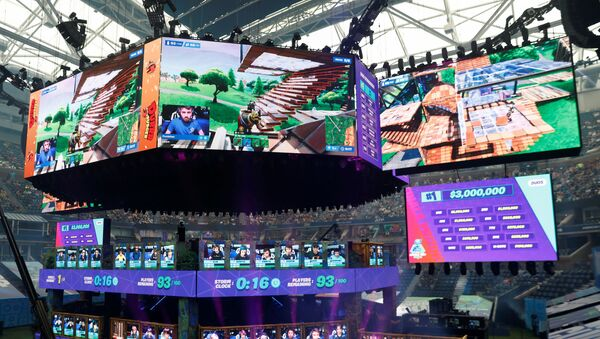 Contestants compete during the Fortnite World Cup Duos Finals at Flushing Meadows Arthur Ashe stadium in the Queens borough of New York, U.S., July 27, 2019. - Sputnik International