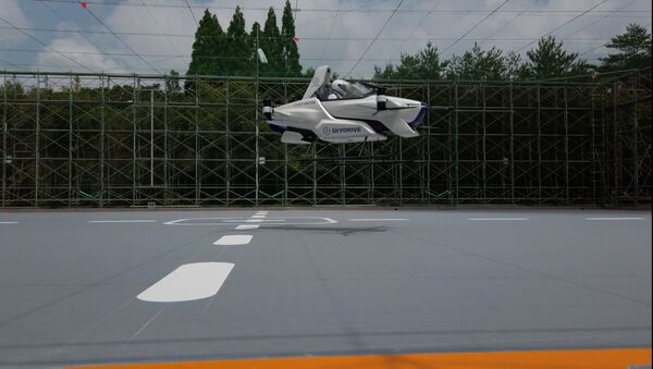 A manned flying car SD-03 is seen during a test flight session at Toyota test field in Toyota, central Japan, in this handout photo taken in August 2020 and released by SkyDrive/CARTIVATOR 2020, and obtained by Reuters August 29, 2020. SkyDrive/CARTIVATOR 2020 - Sputnik International