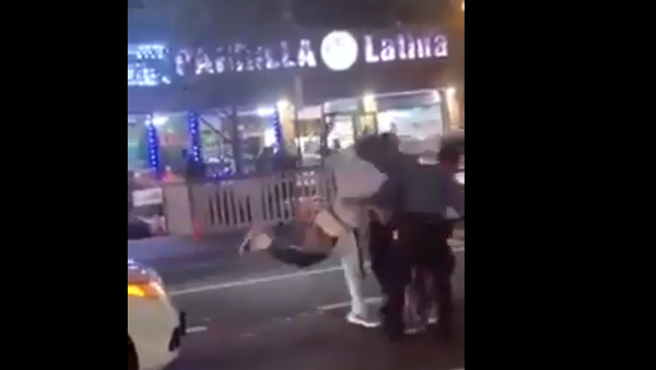 A screenshot from a video of a driver assaulting two New York Police Department traffic officers in the Bronx, New York, US, on 26 August 2020. - Sputnik International