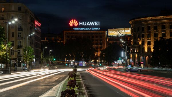 Cars drive past a Huawei logo on a building in central Belgrade, Serbia, August 11, 2020. Picture taken August 11, 2020. Picture taken with a long exposure - Sputnik International