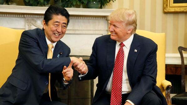 Japanese Prime Minister Shinzo Abe shakes hands with U.S. President Donald Trump (R) during their meeting in the Oval Office at the White House in Washington, U.S., February 10, 2017. - Sputnik International