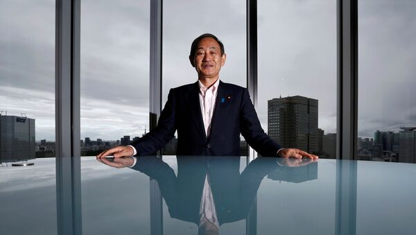 Japan's Chief Cabinet Secretary Yoshihide Suga poses for a photograph during a Thomson Reuters Newsmaker event in Tokyo, Japan August 30, 2016. - Sputnik International