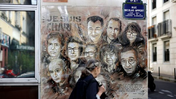 A woman walks past a painting by French street artist and painter Christian Guemy, known as C215, in tribute to members of Charlie Hebdo newspaper who were killed by jihadist gunmen in January 2015, in Paris, on August 31, 2020. - Fourteen alleged accomplices in the 2015 jihadist attacks on the Charlie Hebdo satirical weekly, on a kosher supermarket and in the southern Paris suburb Montrouge go on trial on September 2, more than half-a-decade after days of bloodshed that still shock France. The attacks heralded a wave of Islamist violence that has left 258 people dead and raised unsettling questions about modern France's ability to preserve security and harmony for a multicultural society. - Sputnik International