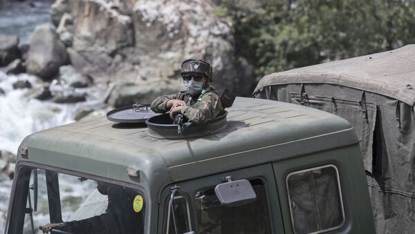 An Indian army soldier keeps guard on top of his vehicle as their convoy moves on the Srinagar- Ladakh highway at Gagangeer, northeast of Srinagar, Indian-controlled Kashmir, Tuesday, Sept. 1, 2020 - Sputnik International