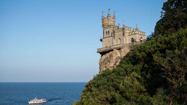 A vessel passes the Swallow's Nest castle overlooking the Black Sea outside Yalta, Crimea, Russia - Sputnik International
