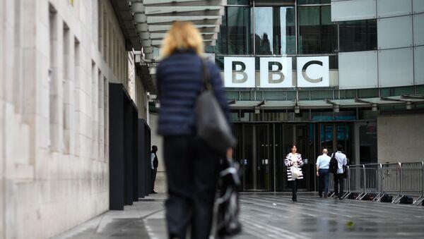 People walk outside the BBC headquarters in Portland Place, London on July 2, 2020.  - Sputnik International