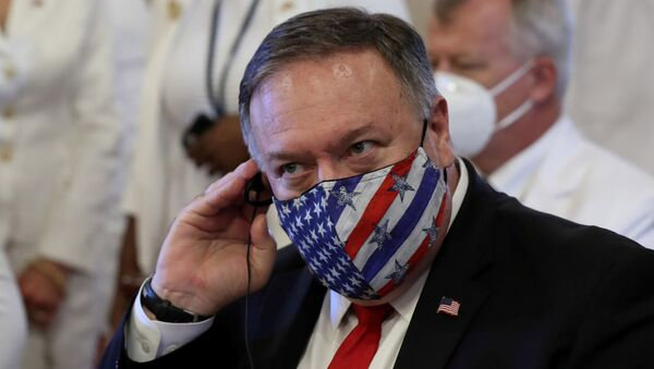 U.S. Secretary of State Mike Pompeo adjusts his earphones during a Te Deum as part of the swearing-in ceremony of Dominican Republic's new President Luis Abinader in Santo Domingo, Dominican Republic August 16, 2020 - Sputnik International