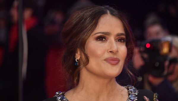 Mexican-US actress Salma Hayek poses on the red carpet upon arrival for the premiere of the film The Roads Not Taken screened in competition on February 26, 2020 at the 70th Berlinale film festival in Berlin. - Sputnik International