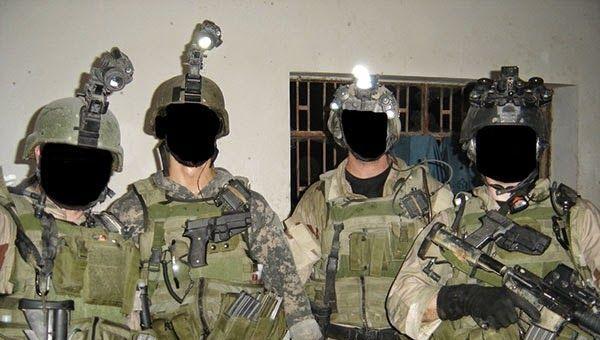 Four mercenaries belonging to Keenie Meenie Services with faces blacked out - Sputnik International