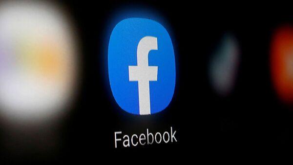 A Facebook logo is displayed on a smartphone in this illustration taken 6 January 2020 - Sputnik International