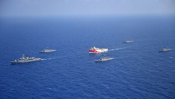 This handout photograph released by the Turkish Defence Ministry on August 12, 2020, shows Turkish seismic research vessel 'Oruc Reis' (C) as it is escorted by Turkish Naval ships in the Mediterranean Sea, off Antalya on August 10, 2020. - Sputnik International