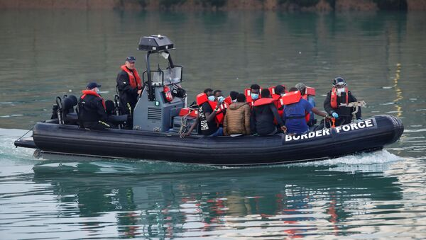 Migrants are brought to Dover harbour by Border Force, in Dover, Britain August 12, 2020 - Sputnik International
