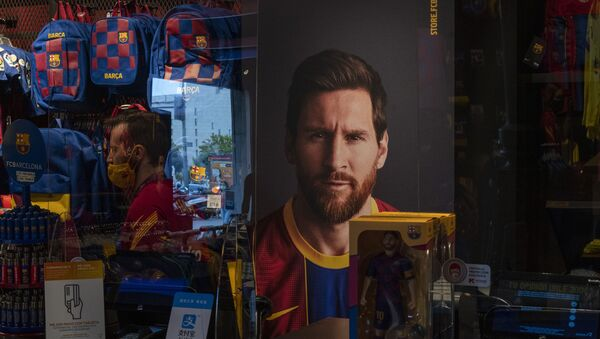 A poster with the face of Barcelona soccer player Lionel Messi is displayed at a F.C. Barcelona store in Barcelona, Spain on Tuesday, Sept. 1, 2020 - Sputnik International