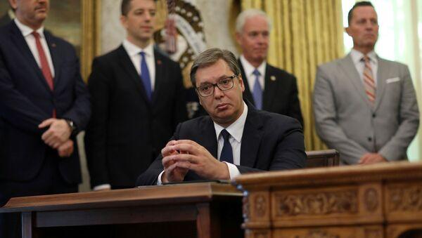 Serbia's President Aleksandar Vucic listens as U.S. President Donald Trump speaks during a signing ceremony with Kosovo's Prime Minister Avdullah Hoti at the White House in Washington, U.S., September 4, 2020. - Sputnik International