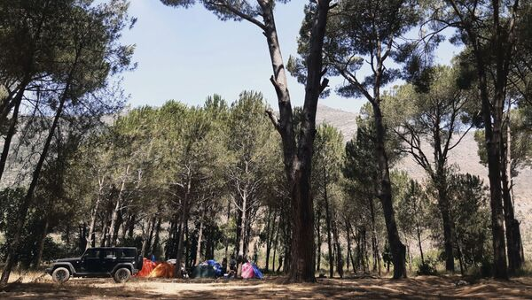 Lebanese protesters take a break during a sit-in against the Bisri dam project, in the Bisri Valley, 58 kilometers (36 miles) southeast of Beirut, Lebanon, Tuesday, July. 21, 2020.. - Sputnik International