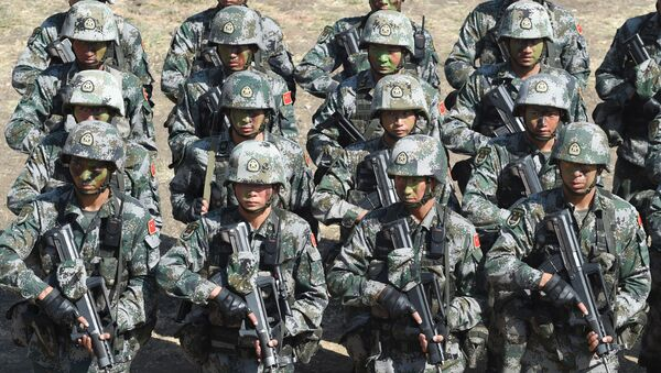People's Liberation Army (PLA) of China soldiers line up after participating in an anti-terror drill during the Sixth India-China Joint Training exercise Hand in Hand 2016 at HQ 330 Infantry Brigade, in Aundh in Pune district, some 145km southeast of Mumbai, on November 25, 2016. - Sputnik International