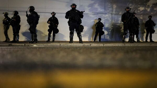 Police stand guard outside the Portland Police Bureau building as protesters demonstrate against police violence and systemic inequality for the 99th consecutive night in Portland, Oregon, U.S. September 4, 2020. - Sputnik International