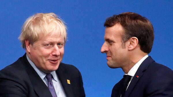 Britain's Prime Minister Boris Johnson welcomes France's President Emmanuel Macron at a NATO leaders summit in Watford, Britain on 4 December 2019. - Sputnik International