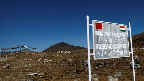 A signboard is seen from the Indian side of the Indo-China border at Bumla, in the northeastern Indian state of Arunachal Pradesh, November 11, 2009 - Sputnik International