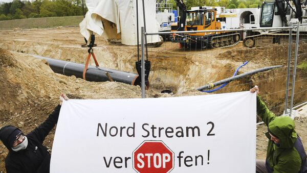 Activists occupy a German pipeline building site in Wrangelsburg, northern Germany, Thursday, May 16, 2019 - Sputnik International