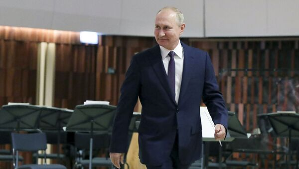 Russian President Vladimir Putin walks to make an address, during the opening of the Concert Hall in the Zaryadye Park near the Kremlin marking the Day of the City in Moscow, Russia, Saturday, Sept. 5, 2020 - Sputnik International