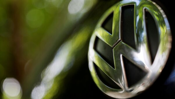A logo of German carmaker Volkswagen is seen on a car parked on a street in Paris, France, July 9, 2020 - Sputnik International