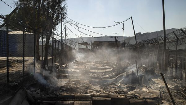 A picture taken on September 9, 2020 shows the burnt camp of Moria on the island of Lesbos after a major fire broke out. - Sputnik International