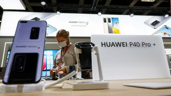 A visitor is seen at a Huawei P40 Pro+ stand at the IFA consumer technology fair, amid the coronavirus disease (COVID-19) outbreak, in Berlin, Germany September 3, 2020 - Sputnik International