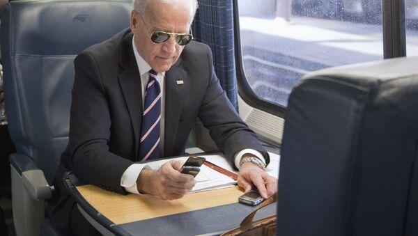 Vice President Joe Biden makes a phone call on a train at Union Station in Washington, Tuesday, Feb. 8, 2011, as he headed to an event in Philadelphia to tout plans to improve the nation's infrastructure - Sputnik International
