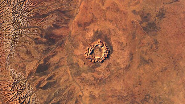 This handout image courtesy of NASA's Earth Sciences and Image Analysis Laboratory obtained 16 June 2003 shows Gosses Bluff, an impact crater in Australia's Northern Territory - Sputnik International