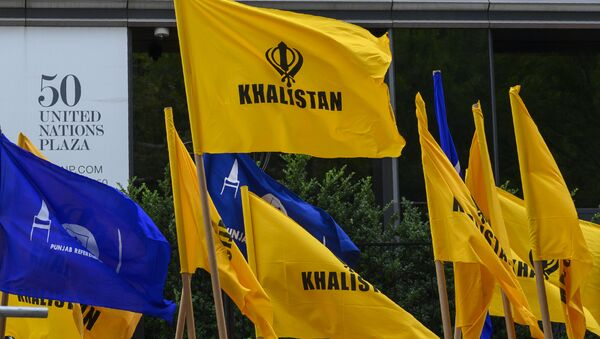 Khalistan flags fly as Sikhs for Justice hold a march and rally at the United Nations Headquarters on Indian Independence day, highlighting the human rights abuses of Sikhs in Punjab by Indian Prime Minister Narendra Modi's government August 15, 2019 in New York. - Sputnik International