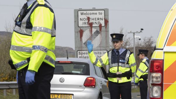 In this file photo taken on April 09, 2020 Irish Police (Garda) stop and check vechicles at the border crossing at Carrkcarnon, County Louth, Ireland, on April 9, 2020 under new powers to curb non-essential travel during the coronavirus crisis. - Sputnik International
