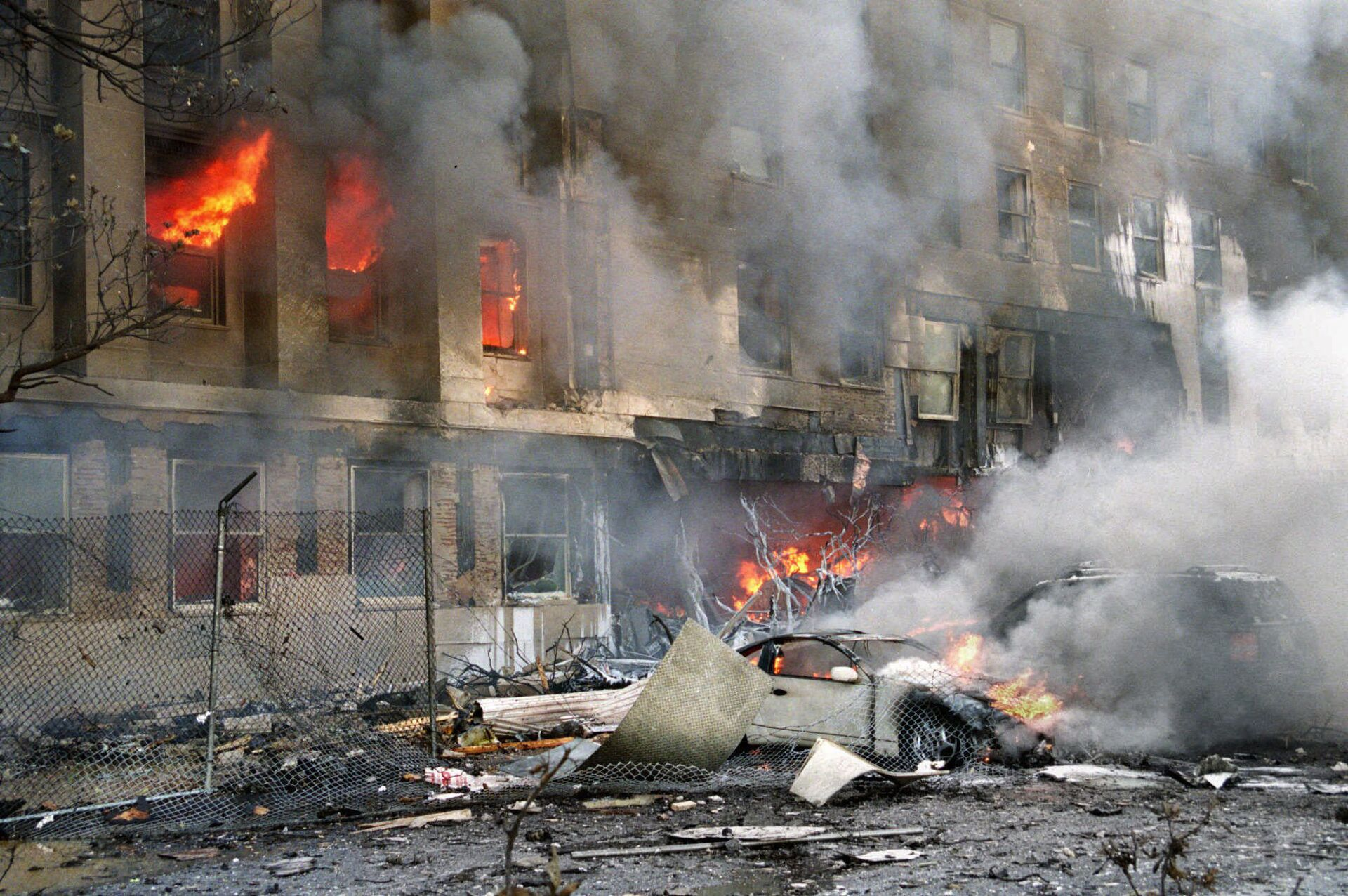 In this 11 September 2001 file photo, damage to the outer ring of the Pentagon is shown after a hijacked airliner crashed into the building - Sputnik International, 1920, 07.09.2021