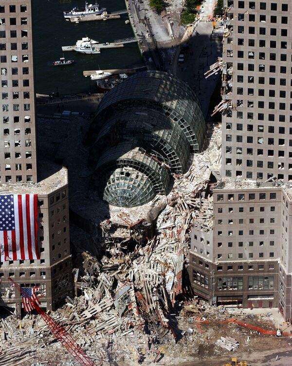 An aerial view shows a small portion of the scene where the World Trade Center collapsed following the 11 September terrorist attack - Sputnik International