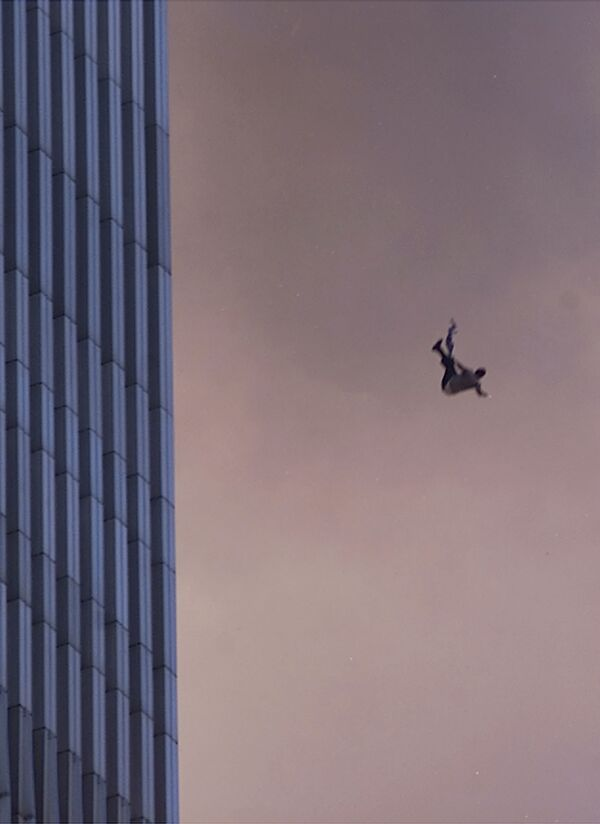 A person falls to his death from the World Trade Center after two planes hit the Twin Towers on 11 September 2001, in New York City - Sputnik International